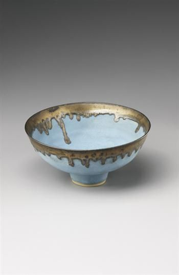 Lucie Rie: Footed bowl, Stoneware, barium blue glaze, golden manganese glaze. 8 1/4 in. (21 cm.) diameter, c.1980