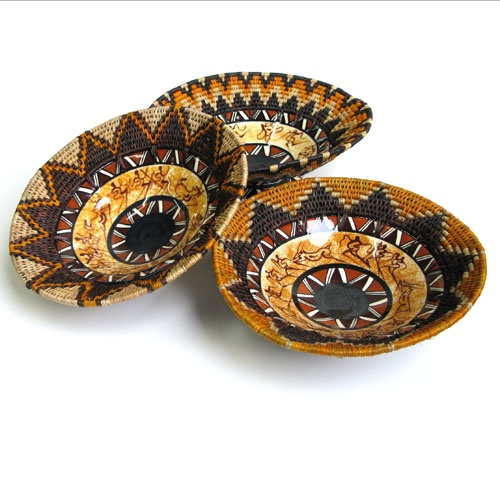 Ceramic Bushman Bowl - Fair Trade - Global Goods Partners - This Ceramic Bushman Bowl will add spirit and elegance to your coffee table. This distinct bowl, made from hand painted ceramic and woven grass, reflects the vibrant art and culture of Swazi life.