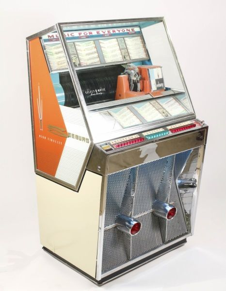 """Silver age 1958 Seeburg Model 161 Jukebox with twin grill fins, visable mech contained within a narrow dimension cabinet with 160 selections which became the industry standard. Features EP (Extended Play) record play using a dual pricing unit. This is Seeburg's first 160 selection unit and is relatively rare with less than 2,000 of them made. The best-selling songs of 1958 included """"Volare,"""" """"Tom Dooley"""" and """"Purple People Eater,"""" """"Tequila,"""" """"Splish Splash"""" and """"To Know Him Is To Love Him."""""""