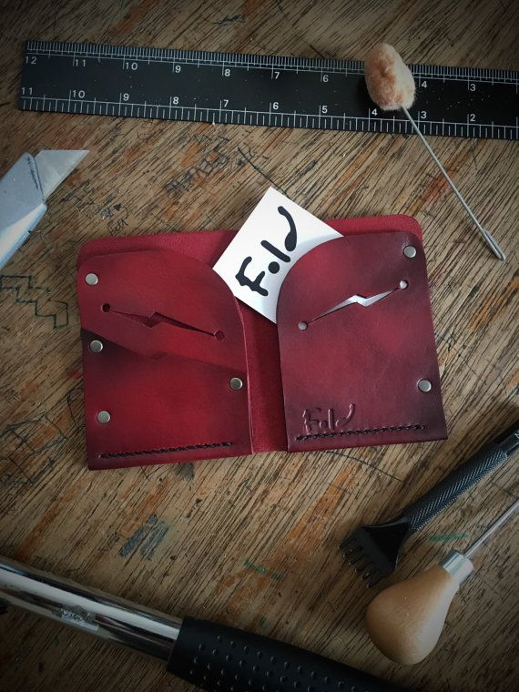 Handmade mens Leather Wallet, with 2 lightening slots which carry up to 5 cards each, additional pocket to left side. The wallet is ready to ship, was hand cut, dyed, stamped, stitched and finished with antique nickel rivets for a cool stylish look. All our leather wallets come boxed and