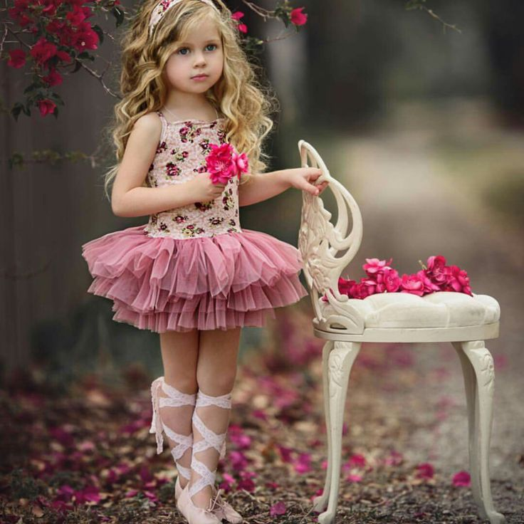 Such a doll! Cute picture of little girl in tutu and lace up ballet slipping.