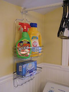 Perfect organization for a small laundry room, but how did they get the shower-organizer over the rod