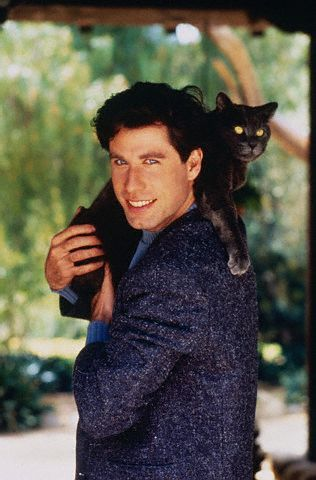 Travolta and his cat (I don't find this pic awkward...and in an odd way the kitty resembles John)