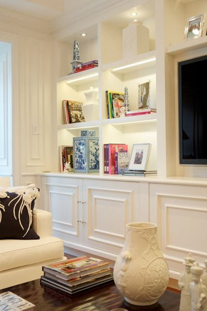 A Blue And White Miami Manse The Glam Pad Lighting In Built Shelves Bookcase Entertainment Center