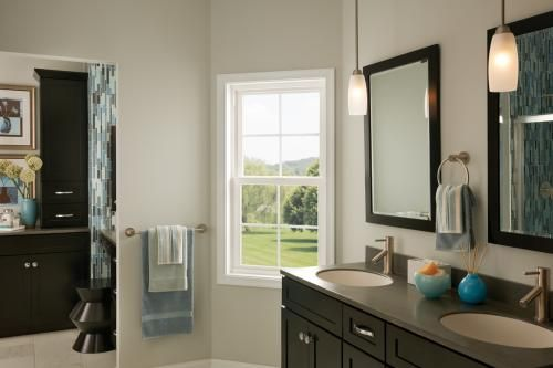 White bathroom windows with colonial grids. Featuring:Tuscany Series single hung window View  our photo gallery for more inspirational  window ideas.