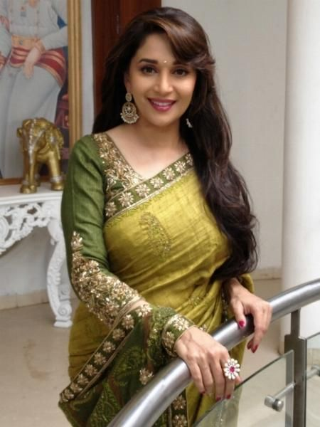 I was going though Madhuri Dixit's website & found some of these pics. Sharing with fellow fans :)  ...
