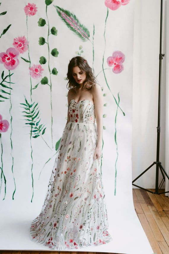 Havent you ever been in a fairy tale before? The Amalthea dress is a jaw dropping embroidered gown perfect for an unconventional wedding dress, prom dress or gown for any spring or summer formal event. A simple silhouette puts the focus on the embroidered floral that climbs from the base of the skirt up to the bodice.  Available in white (shown) or black.  ☽☆☾ Made in Canada with high quality materials, Boned at the bust to ensure it stays up, and fully lined with cotton for a comfortable…