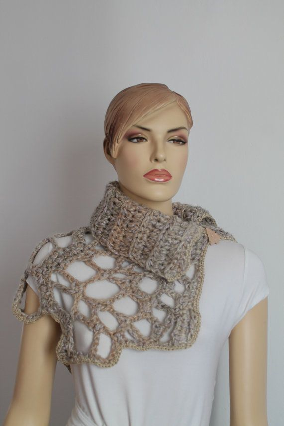 It is a very warm and soft accessory. This piece can be worn with any fashion style you want. Materials: Wool, Mohair, Acrylic, wooden buttons.  Care