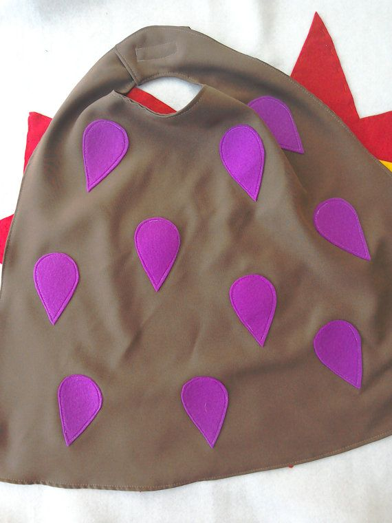 Gruffalo cape of brown polyester with purple felt prickles on the back. Fastened…
