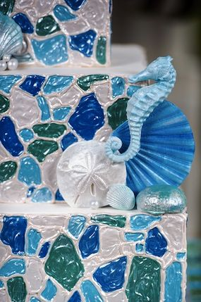 Close up of the detail on a sea glass mosaic wedding cake - what a gorgeous beach themed wedding cake!