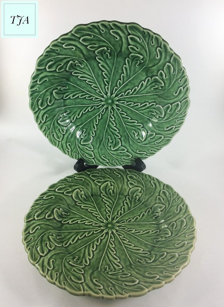 Bordallo Pinheiro Pinwheel Dinner Plates set of 2  Embossed leaves in a pinwheel design and in Green.  10 inch wide plates. Some crazing no chips.  Made in Portugal.