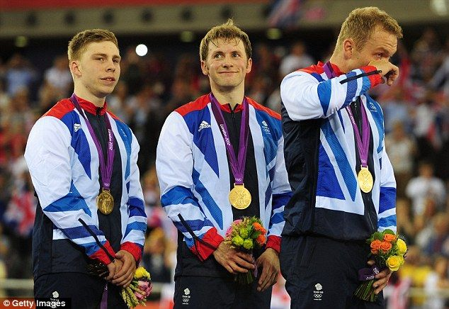 Men's track cycling team sprint gold medal winners - Philp Hindes, Jason Kenny and Sir Chris Hoy wiping away a tear on the podium.