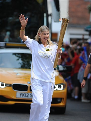 Olympian Sharron Davies carries the Flame through Leominster in Day 6 of the London 2012 Olympic Torch Relay