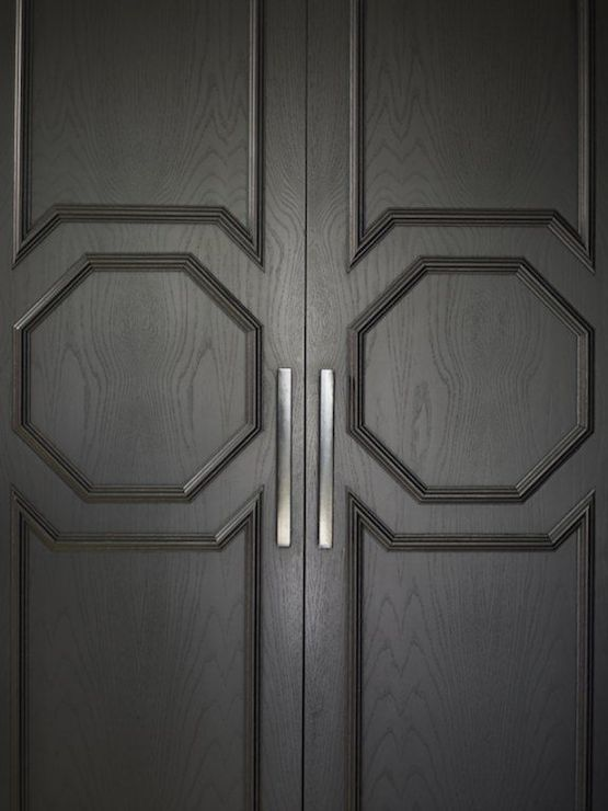 black double exterior doors with regency style molding. it doesnt get sexier than this