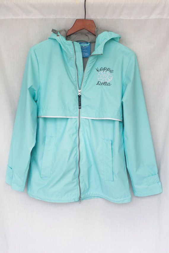 Teal blue Charles River mesh lined full zip hooded rain jacket with Kappa Delta grey script & white nautilus shell embroidered. This jacket is