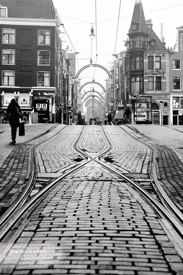 This photographer has a good eye for details. Love the patterns of tram tracks and the repeating arches of the overhead shapes.