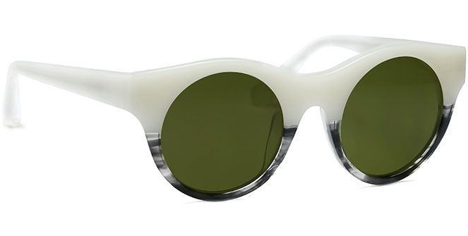 If you want to make a splash with your choice of shades while looking totally on trend at the same time reach for Olive's unique style details. The unusual and striking white and black horn hue, solid round lenses, and elongated flair means you'll garner maximum attention. Olive would look great worn with smart casual linen trousers and a silk shirt, and would be the perfect choice to attend a graduation ceremony or social summer barbeque.