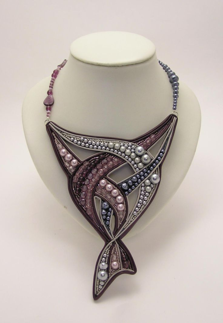 ♥ Love the concept... Not sure of the artist's name... seems to be a combo of bead embroidery and soutache-like trim.