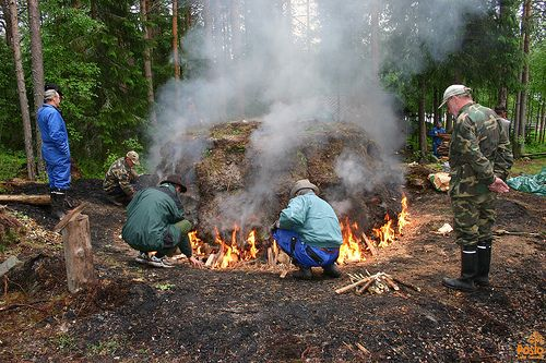 Charcoal pit is set of fire at Sirniö Blacksmith Event