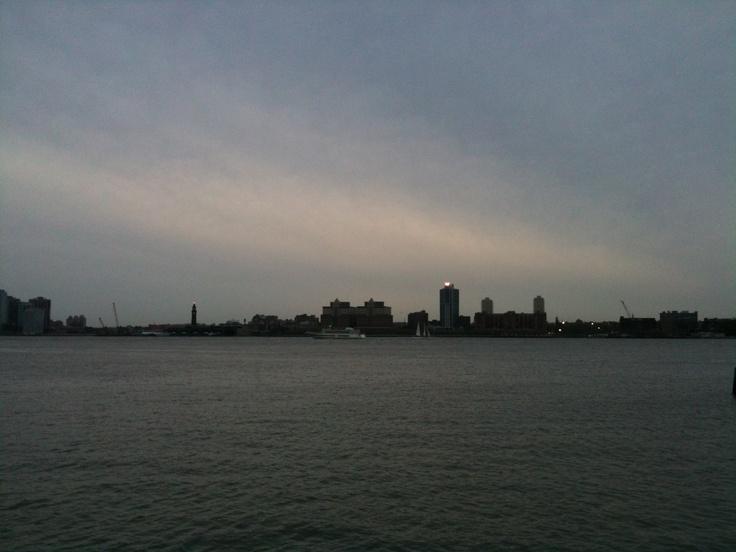 W. Yachts. Lighthouse. Cloudy dusk.