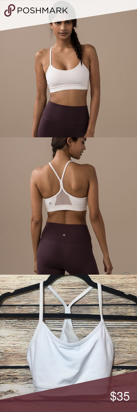 Lulu 🍋 Flow Y Sports Bra - size 6 White sports bra from lululemon in size 6 - good condition but I am between a 4-6 in lulu and this was a little big. No padding included. lululemon athletica Intimates & Sleepwear Bras