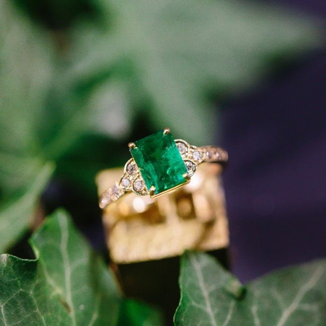 Stunning vintage-inspired Emerald Cut emerald & diamond engagement ring