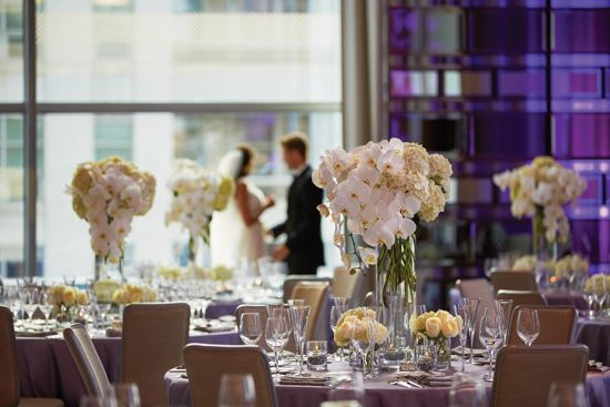 Centerpieces with white orchids and hydrangeas