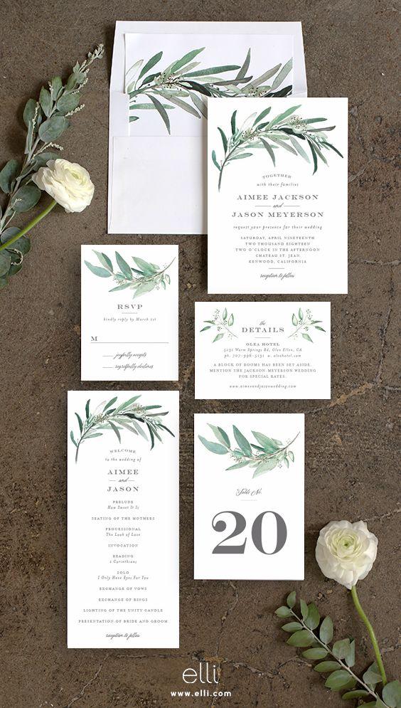 Lush greenery wedding invitation suite.