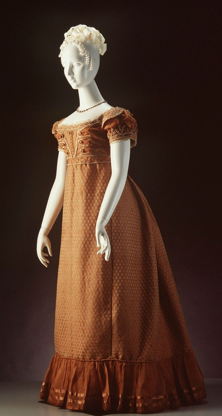 Circa 1820 Evening Gown, English: figured silk, muslin, and trimmed with silk passementerie.