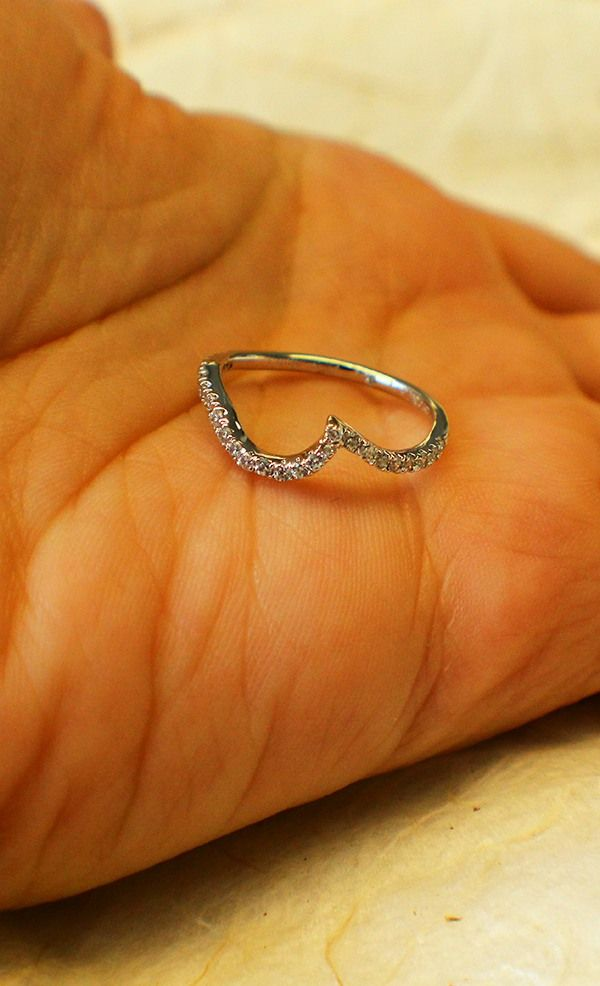 This gently curved wedding band symbolizes a heart that's been taken.