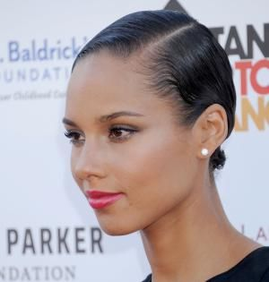 Everything from updos to short naturals are chic enough for the holidays! This gallery of holiday hairstyles for black hair is full of ideas for you!: Holiday Hairstyles: Alicia Keys