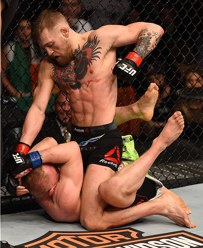BOSTON, MA - JANUARY 18: Conor McGregor of Ireland punches Dennis Siver of Germany in their featherweight fight during the UFC Fight Night event at the TD Garden on January 18, 2015 in Boston, Massachusetts. (Photo by Jeff Bottari/Zuffa LLC/Zuffa LLC via Getty Images)