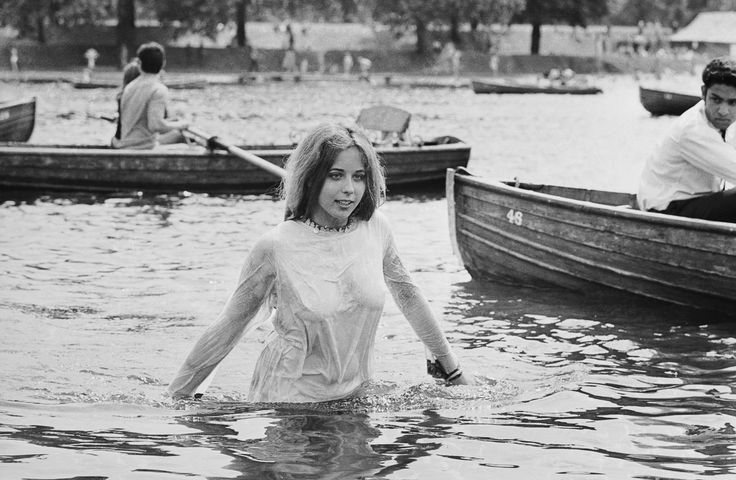 """A concertgoer cools off in the Serpentine in Hyde Park.  Image: Reg Burkett/Express/Getty Images (via Mashable """"1969: Rolling Stones in Hyde Park"""")"""
