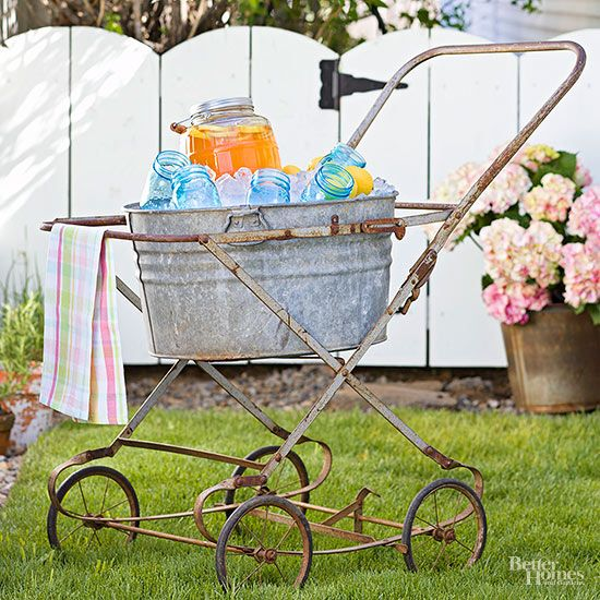 Pair a galvanized-tin tub with an old baby-buggy frame to fashion a playful alfresco entertaining cart.
