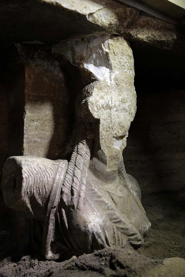 Amphipolis, Macedonia Greece: The damaged face of the East Caryatid - The face is damaged and the arm is broken, but the East Caryatid originally had one of her hands outstretched to symbolically keep out anyone who would attempt to enter the Tomb.