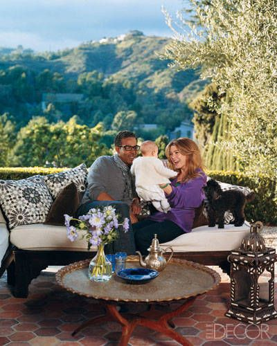 Ellen Pompeo and her husband, music producer Chris Ivery, snuggle with their 7-month-old daughter, Stella Luna, at their house in the Hollywood Hills.