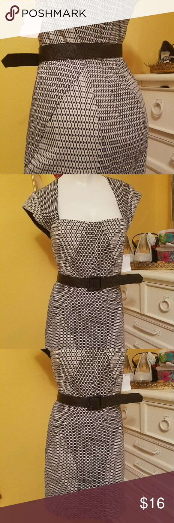 (New)Nicole Miller Dress Cute! Seems like it's form fitting. Fits an 8 best although Mannequin is a size 6 and with belt she is working it also! Seems like it was made to enhance certain areas😉 through the pattern cut. BUNDLE AND SAVE and feel free to offer. Looks like its a darker navy blue color( tag says Navy). Not sure if it's Black, maybe I am color blind. Belt not included. Does have lining! Dresses