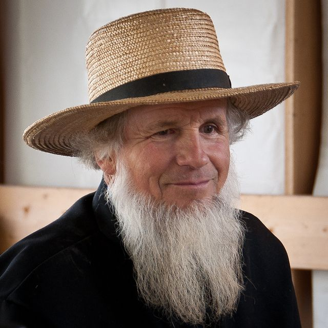 Amish man with summer hat - Ordnung rules state males are to wear hats when outside. Black is for the winter, straw color is for the warmer months. Amish are prohibited from wearing jewelry, not even wedding rings can be worn. Other symbols (beards for men, and black bonnets for women) are used, in lieu of rings, to represent marital status.