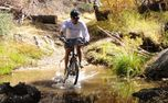 Mountain bike on professional tracks - Hard - Not afraid to get wet while mountain biking.