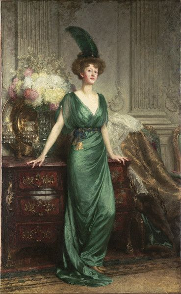 """Portrait of the Hon. Mrs Ernest Guinness, standing, full-length, wearing an emerald dress and feather,"" SIr Frank Bernard Dicksee, 1912. Oil on canvas."