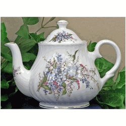 DescriptionOne of our most popular patterns, our Forget Me Not 6 cup teapot is just the right size for having tea with friends. Beautifully decorated with vibrant colors, this teapot features a full spring of Forget Me Nots, and is also decorated on the lid and spout.    Part of our English Heirloom Collection, our Forget Me Not 6 cup teapot is made of fine bone china.