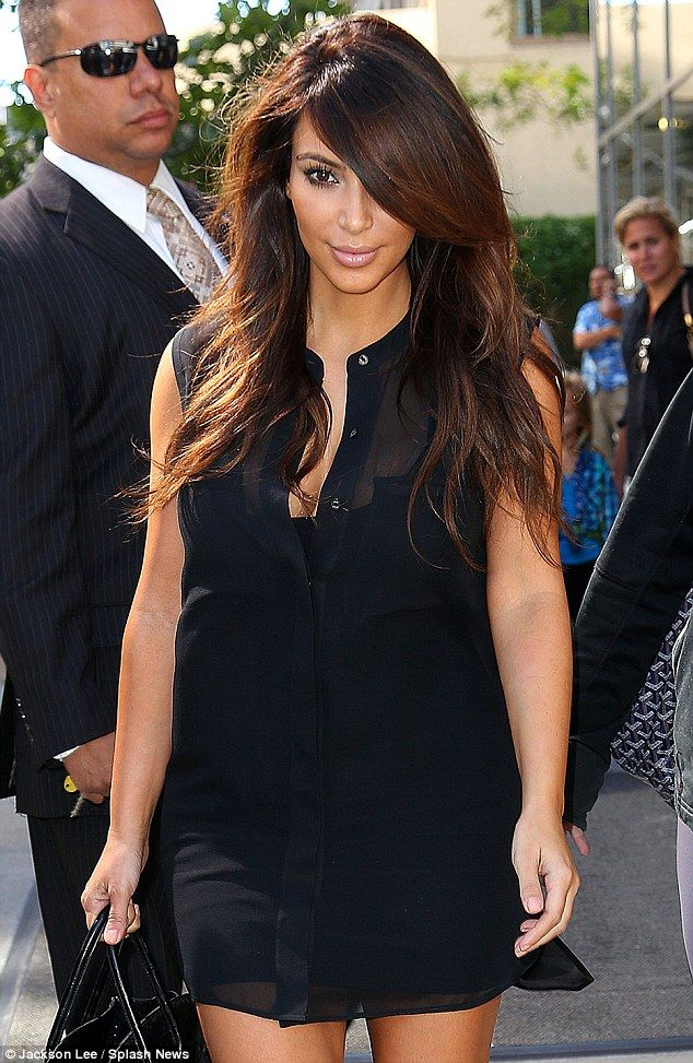 Kim Kardashian steps out in ANOTHER transparent outfit and almost exposes herself