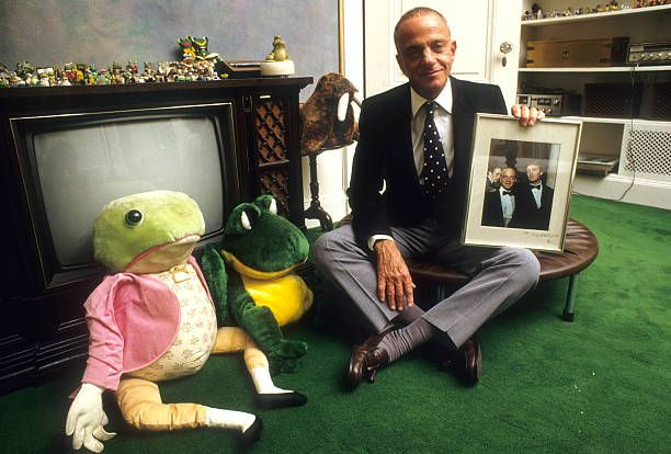 Portrait of lawyer Roy Cohn at home posing with stuffed toy frogs and holding a photo of him and Donald Trump Cohn is counselor and advisor to New...