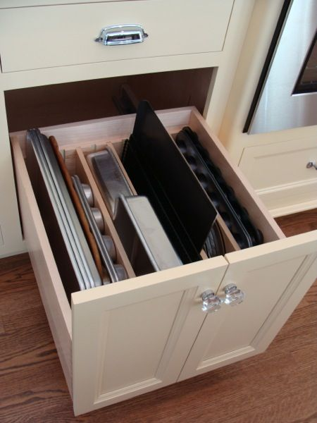 A good idea for storing baking trays. Trays are divided by kind inside a kitchen drawer. Just pull the drawer and pull out a tray.