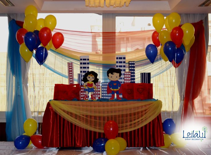 Candy Table for Super Man and Wonder Woman Themed Birthday Party Decorations by Leila Events (04098). For orders or further info call or whatsapp +201222220889