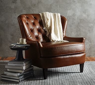 "I wanted a leather chair for reading in my studio, but my sister said it didn't come across as ""studious intellectual"" chair but more as ""Scotch drinking, cigar-smoking"" chair.   Cardiff Leather Armchair #potterybarn"