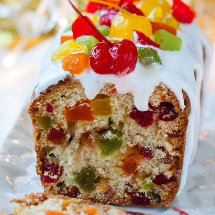 This fruitcake recipe can is one you can bake and eat without waiting time.  It is easy to do and produces two 9x5 inch delicious colorful loaves.Perfect for a holiday treat.. No Wait Fruit Cake With Snow White Glaze Recipe from Grandmothers Kitchen.
