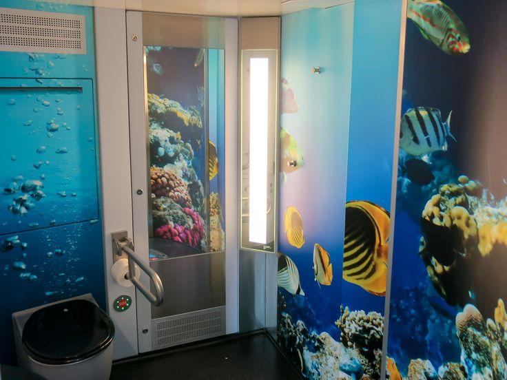 Underwater environmental graphic themed toliets on Pågatågens trains. Design and concept ideas  #graphic #design #illustrations #fun #bathroom #environmental #graphics #creative #toliet
