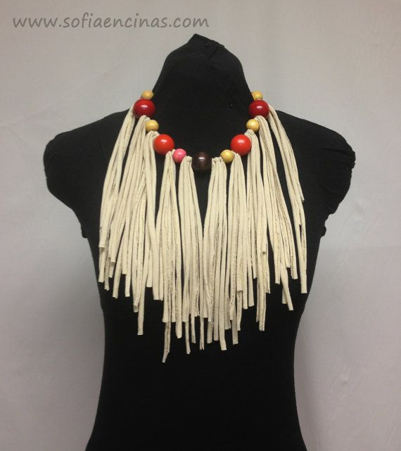 The necklace is made out of strips of fabric taken from upcycled t-shirts, and vintage wooden beads, colors red, orange, yellow, pink and brown. The beige tassels go down to from the neck. The necklace has a tie/knot close in the back.   The tassels measure approximately 8 inches.