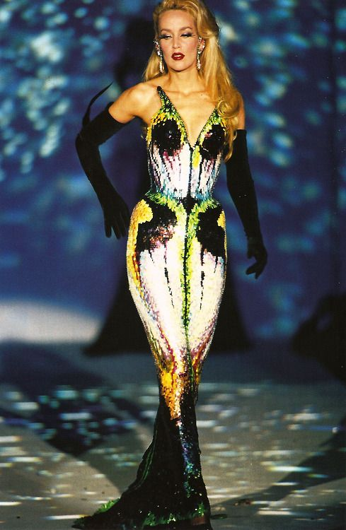 Jerry Hall wears a strapless butterfly-wing sheath dress embroidered with multicolored sequins (Mr Pearl) and long black velvet gloves.  Thierry Mugler 'Les Insectes' Couture Collection Spring/Summer 1997 Photo by Patrice Stable